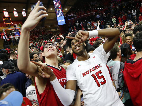 The NCAA's highest governing body supports allowing student-athletes to be compensated for third-party endorsements, along with receiving money from other avenues. Here, Rutgers center Myles Johnson celebrates with fans after defeating Maryland in March, before the season was halted.