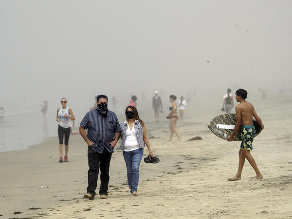 Beachgoers flocked to Orange County seashores on Sunday, as pictured here in Huntington Beach. An order announced Thursday, by California Gov. Gavin Newsom will prohibit people from visiting any beaches or state parks in Orange County.