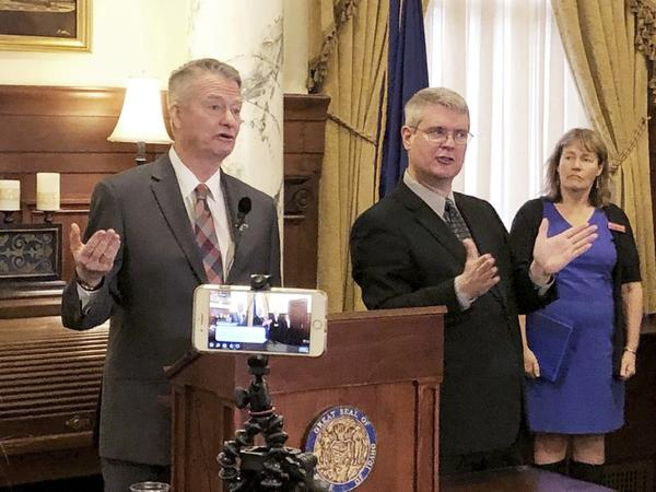 File photo. Idaho Gov. Brad Little, left, announces stricter guidelines for social interactions to slow the spread of the new coronavirus, and also livestreaming the discussion, at his office in Boise on March 18, 2020.
