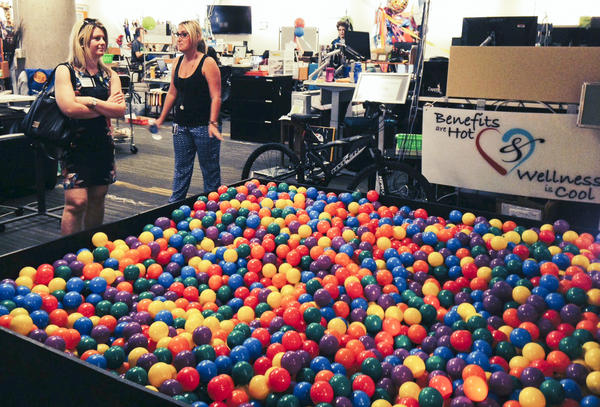 Zappos.com tour guide Erika Newman (right) shows off the ball pit in the human resources department of the company's Las Vegas headquarters. Zappos eliminated managers and embraced a system of self-governance known as holacracy.