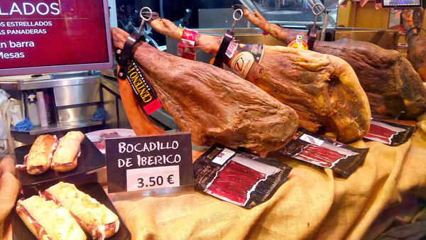 Display of Spanish hams in the front window of a branch of the <em>Museo del Jamón</em>, a chain of ham-themed bars in Madrid.