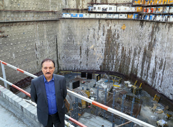 Iranian businessman Ebrahim Pourfaraj in front of 240-foot deep construction site for what he says will be Iran's biggest hotel. Pourfaraj is betting big that the lifting of sanctions will open Iran's economy to the world after years of limited contact.