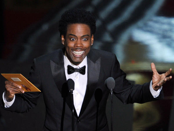 Chris Rock speaks onstage during the 2012 Academy Awards at the Hollywood & Highland Center in Hollywood, Calif.