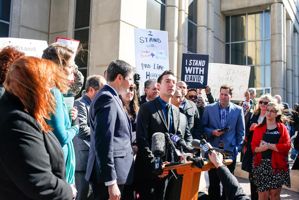 David Daleiden, a defendant in an indictment stemming from a Planned Parenthood video he helped produce, speaks to the media Thursday after appearing in court at the Harris County Courthouse in Houston, Texas.