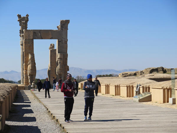 Tourists at Persepolis marvel at the grandeur of a bygone age amid worries about the future.