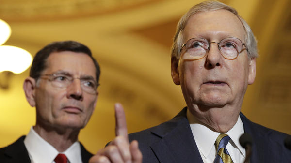 Senate Majority Leader Mitch McConnell, R-Ky., accompanied by Sen. John Barrasso, R-Wyo., meets with reporters on Capitol Hill last month, following a Republican policy luncheon.