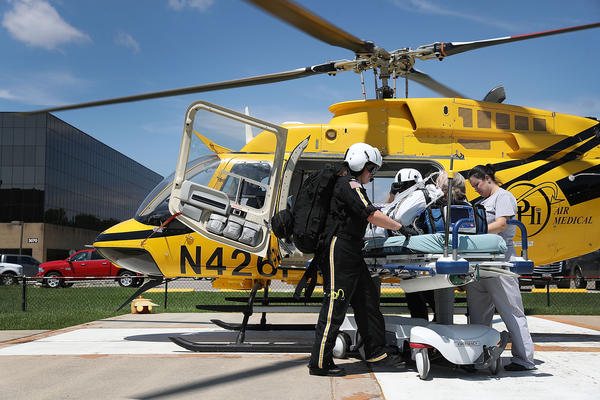 A patient is evacuated from Baptist Hospitals of Southeast Texas in Beaumont, Texas, on Thursday.
