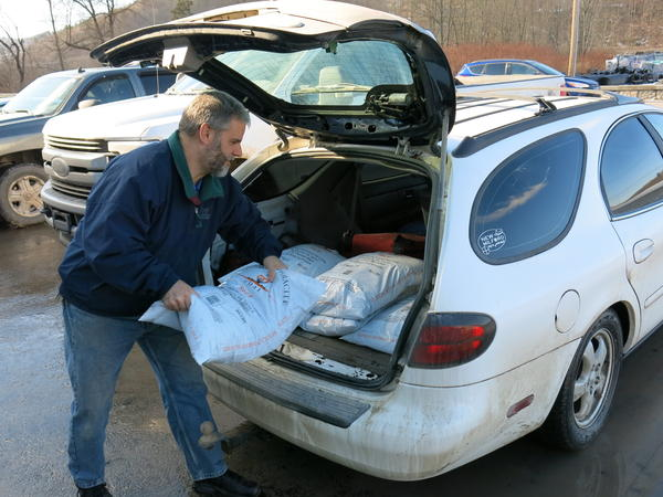 John Ord of Susquehanna, Pa., loads 40-pound bags of anthracite coal into his car. He's among the fewer than 130,000 households left in the United States that burn coal to heat their homes.