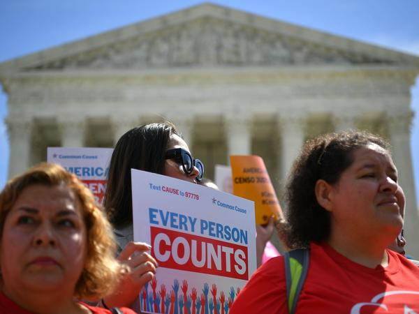 Demonstrators rally outside the U.S. Supreme Court in April to protest against the Trump administration's efforts to add a citizenship question to the 2020 census.