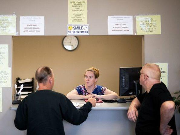 "Clarisa Corber at work at a Topeka, Kan., insurance agency. Corber and her husband — who have three kids, a health plan and $15,000 in medical debt — were profiled in a recent <em>Los Angeles Times</em> <a href=""https://www.latimes.com/politics/la-na-pol-health-insurance-medical-debt-20190502-story.html"">investigation into the effects of high-deductible health plans</a>."