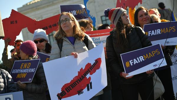 People rally in front of the Supreme Court on March 26 as the court hears arguments in redistricting cases. The court ruled that partisan redistricting is a political question, not one that federal courts can weigh in on.
