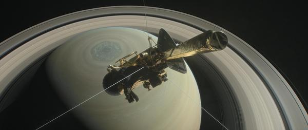 """This illustration shows NASA's Cassini above Saturn's northern hemisphere before making one of its """"Grand Finale"""" dives."""