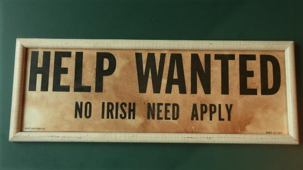 """A now-closed Irish pub in Lawrence, Mass., displayed an old """"Help Wanted/No Irish Need Apply"""" — a common sight across the country in the mid-1800s."""