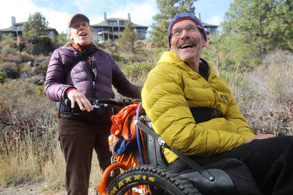 Geoff Babb (seated) hasn't walked since he suffered two brainstem strokes 14 years ago. That prompted him to focus on helping people with serious disabilities access trails, and an outdoor lifestyle.