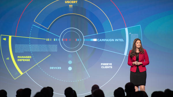 Sandra Joyce, the head of global intelligence at the cybersecurity firm FireEye, speaks at the company's Cyber Defense Summit in 2018. Private tech companies are increasingly taking the lead in reporting information about suspected attacks by foreign actors. In some cases, the companies sell their reports to the U.S. intelligence community.