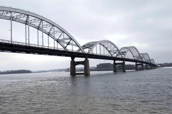 The Centennial Bridge over the Mississippi River connecting Davenport, Iowa and Rock Island, Illinois. Davenport's downtown suffered millions of dollars in lost business after flooding last year.