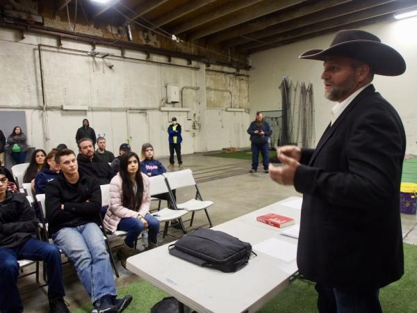 Ammon Bundy, right, rails against Idaho's stay-at-home order to a crowd in Emmett, Idaho, on March 26, 2020.