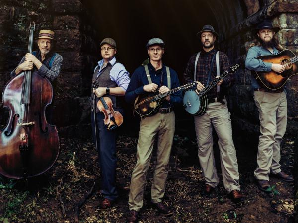 Appalachian Road Show's new album is fittingly called <em>Tribulation</em>. Banjoist Barry Abernathy and fiddler Jim VanCleve spoke to NPR about playing traditional songs of hardship during a modern crisis.
