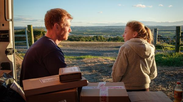 Delivery van driver Ricky (Kris Hitchen) takes a break with his his daughter (Katie Proctor) in the Ken Loach drama <em>Sorry We Missed You</em>.