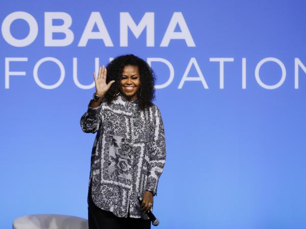Former U.S. first lady Michelle Obama waves as she attends an event for Obama Foundation in Kuala Lumpur, Malaysia, in December 2019. Obama and actress Julia Roberts attended the inaugural Gathering of Rising Leaders in the Asia Pacific organized by the Obama Foundation.