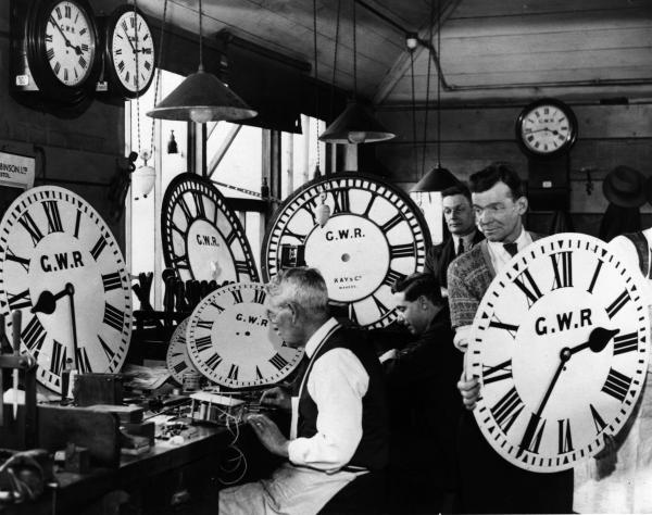 Time keepers: A group of employees at the Great Western Railway's signal works in Reading, test and repair some of the company's many clocks.   (Photo by Harry Todd/Getty Images)