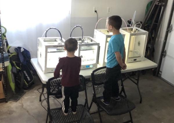 A Meridian Library District staffer created this face shield-making printer farm in his garage using the district's 3D printers that would otherwise be sitting idle.
