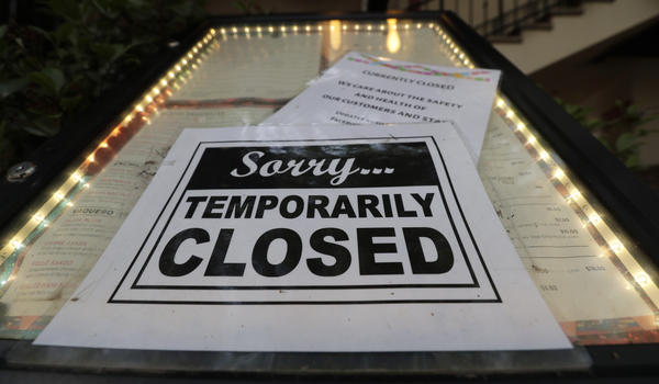A closed sign is posted at a restaurant along the River Walk in San Antonio.