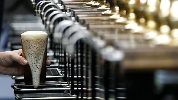 A pint of beer is poured at the 2015 Great British Beer Festival in London. A brewery in the northeast of England is giving away beer to help raise money for the National Health Service during the coronavirus pandemic.