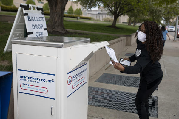 An Ohio voter drops off her ballot at the Board of Elections in Dayton earlier this week. Legal fights around mail-in voting are heating up as states turn to the practice amid the coronavirus pandemic.