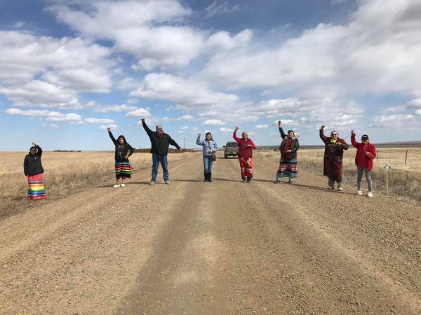 A photo of Prairiedawn Thunderchild, Tahnee Thunderchild, Lance Fourstar, Catherine Bear, Delberta Eagleman, Angeline Cheek, Vermae Taylor and Cheyenne Foote taken Apr. 14, 2020.