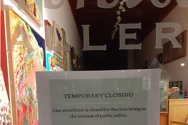 A temporarily closed sign is posted in an art gallery in Bozeman, Montana, March 18, 2020.