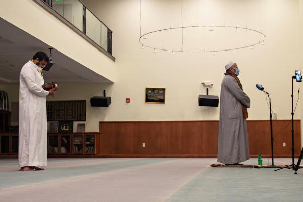Imam Refai Arefin (left) holds a virtual prayer for the first night of Ramadan. Shaykh Syed Farghali recites verses from Chapter Two of the Quran.