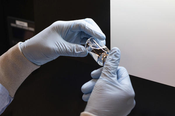 A vial of the investigational drug remdesivir is visually inspected at a Gilead Sciences manufacturing site in the U-S.