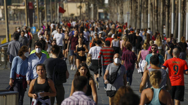 Crowds of people took to a seafront promenade under a brilliant sunny sky in Barcelona, where Spain's strict coronavirus lockdown measures were lifted Saturday so that adults could get some exercise.
