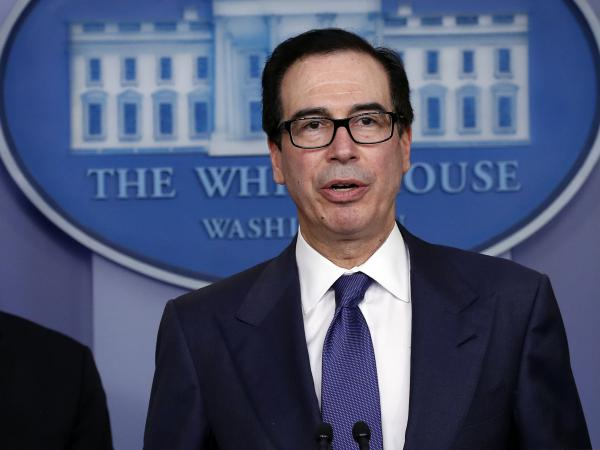 Treasury Secretary Steven Mnuchin speaks about the coronavirus at the White House on March 25. The Treasury said Monday it expects to borrow nearly $3 trillion in the April-June quarter.
