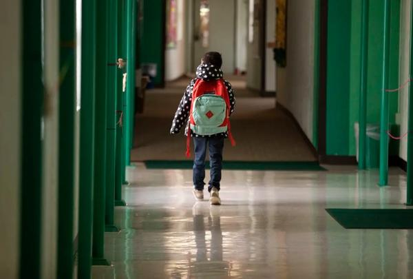 A student walks down the hallway at Cactus Elementary School.