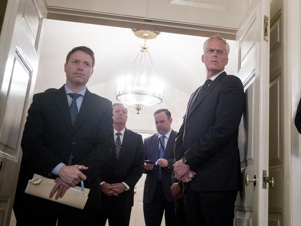 Matt Pottinger, left, President Trump's deputy national security adviser, at a White House event last year. Pottinger delivered a speech on Monday in Mandarin aimed at a Chinese audience.