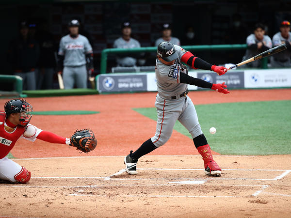 A Hanwha Eagles player bats during the Korean Baseball Organization (KBO) League's opening day game between his team and the SK Wyverns in Incheon, South Korea. The start of the season was originally scheduled for March 28 but was delayed because of the spread of the coronavirus.