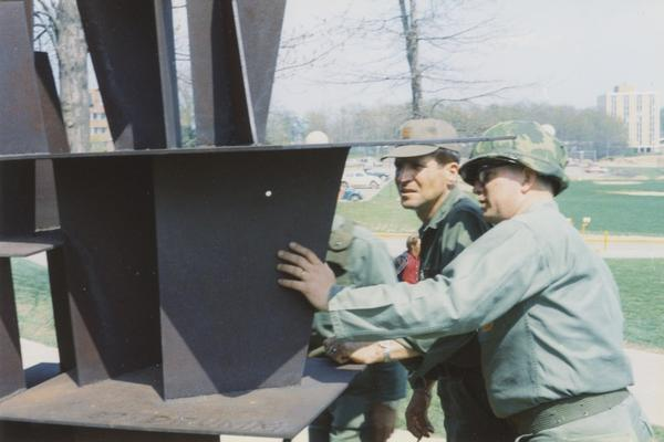 Members of the National Guard examine the Don Drumm sculpture near Taylor Hall on the campus of Kent State University.