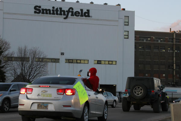 Employees and family members protest outside a Smithfield Foods processing plant in Sioux Falls, S.D. The plant has had an outbreak of coronavirus cases according to Gov. Kristi Noem.