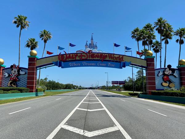 "An empty road in Kissimmee, Fla., leads into a Disney resort that's closed because of the COVID-19 pandemic. ""None of us could've imagined the suffering and sacrifice that we're now seeing around the world,"" the CEO said on an earnings call."