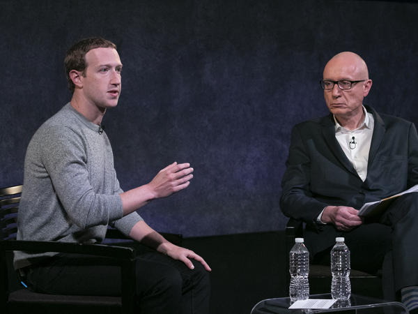 Facebook CEO Mark Zuckerberg, left, has agreed to submit to a newly formed oversight board, which will examine whether to remove posts from the website.