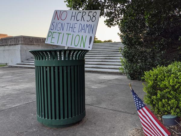 A protester's discarded sign after H&GA voted to advance HCR58
