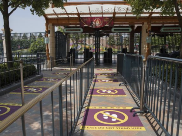 Visitors waiting in line at Shanghai Disneyland will need to maintain physical distancing as part of the theme park's plans to reopen on Monday.