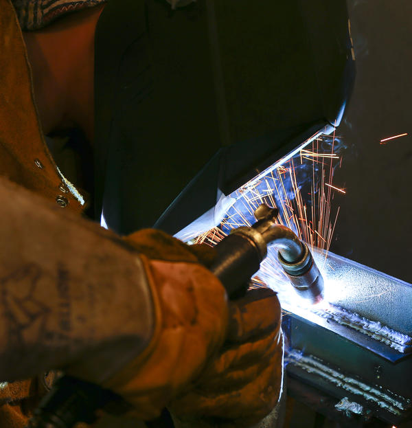 Seth McConnell practices a weld during his welding class at Washburn Tech before the coronavirus shutdown.