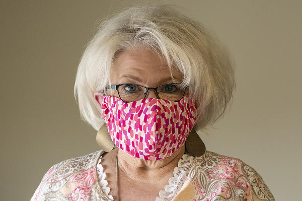 Barb King models a mask sewn at The Whole Person in Kansas City, Missouri.