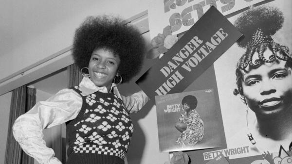 Betty Wright in 1975, when she was 21 years old, stands with a display of some of her album covers. Wright was already a veteran by the time she was out of her teens, having released four studio albums that included multiple songs that would be career signatures.