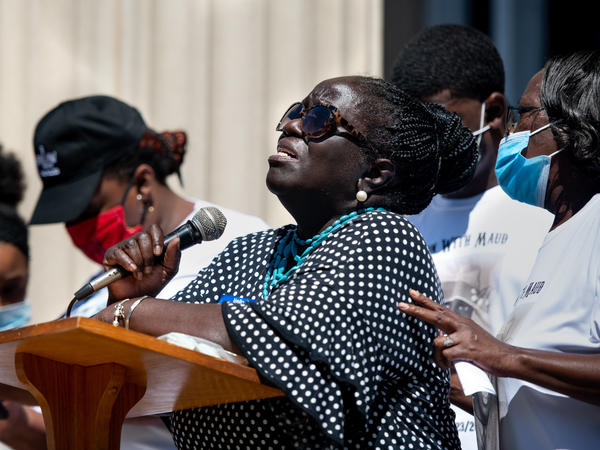 Kimberly Cummings speaks to demonstrators at the Glynn County Courthouse on May 8 in Brunswick, Ga., during a protest over the fatal shooting of her nephew, Ahmaud Arbery.