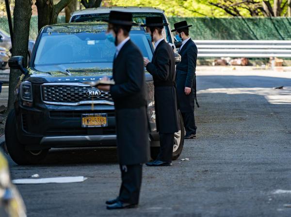 Hassidic Jews Socially distancing on a Willamsburg street during Saturday morning shabbat prayers on May 2.
