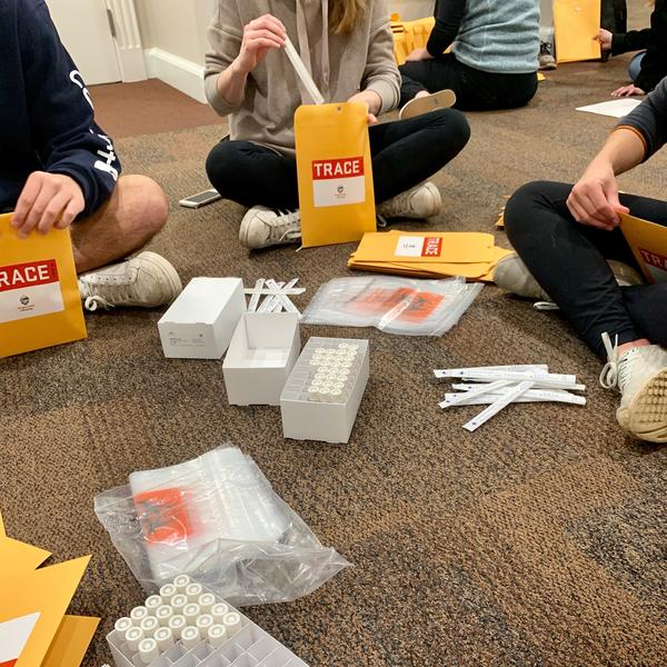 TRACE field staff assemble nasal swabs, collection tubes and other materials into home sampling kits. All field staff are tested for COVID-19 each week prior to working.